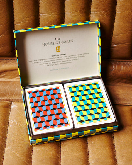 2 sets of playing cards presented in a retro box