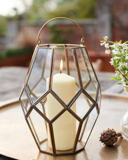 Antique look hand welded glass and brass lantern.