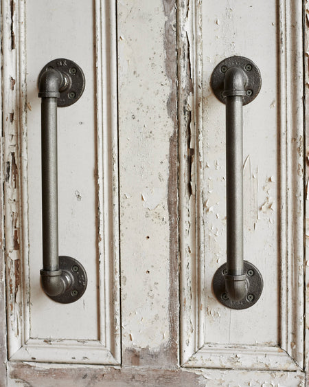 A pair of heavy duty industrial metal door handles