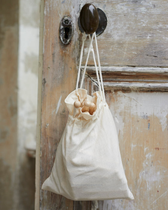 Old school Laundry wooden dolly pegs in canvas bag
