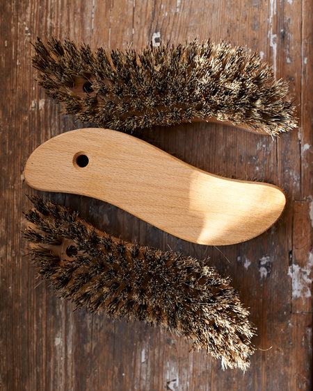 S - shaped oiled beechwood scrubbing utility brush.