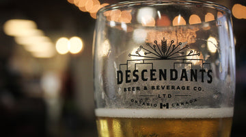 Descendants Brewery glass pint filled with light ale