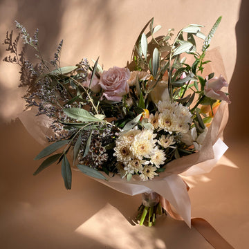 Fresh flower bouquet filled with lots of textures and tones. This bouquet includes wax flower, garden roses, chrysanthemums, white veronica okive branches and more. Same day delivery available in Ottawa, ON.
