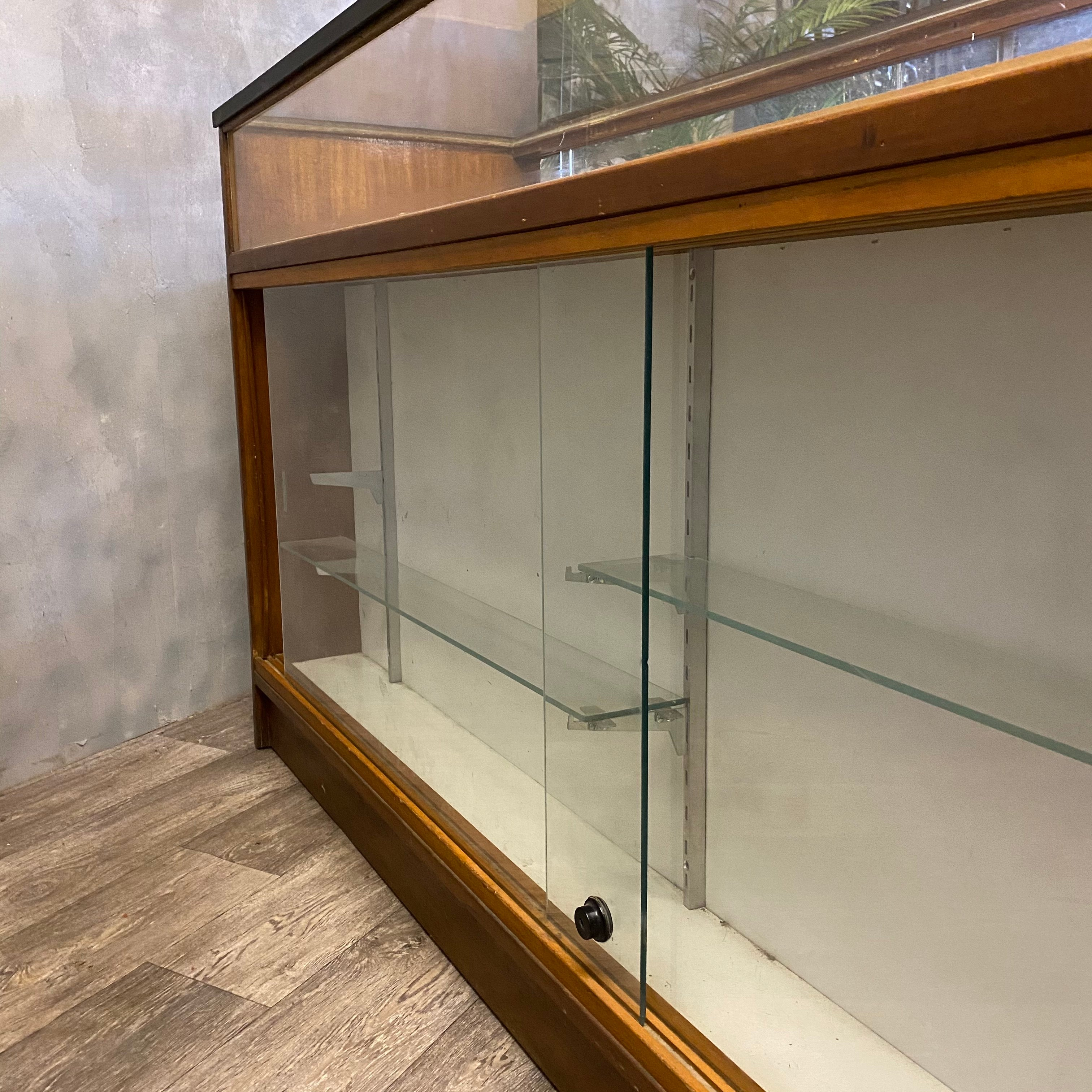 Glass shelving in shop counter