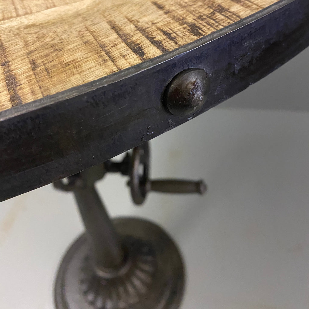 Industrial rivets on mango wood table