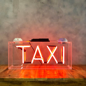 Funky vintage Neon 'Taxi' signage in orange