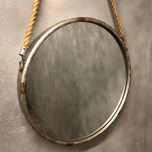 Industrial style mirror with rope hanging.