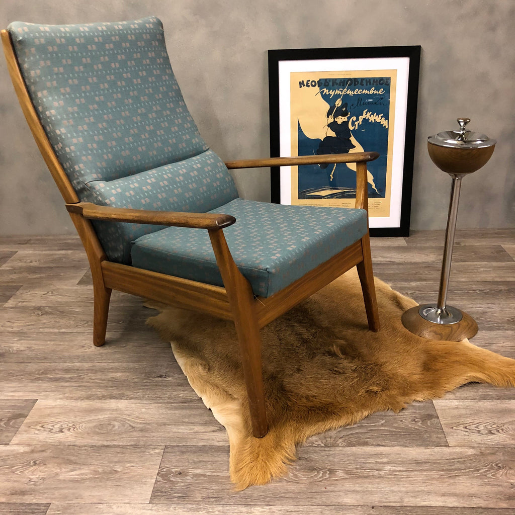 Midcentury lounge chair in blue fabric. Teak frame.