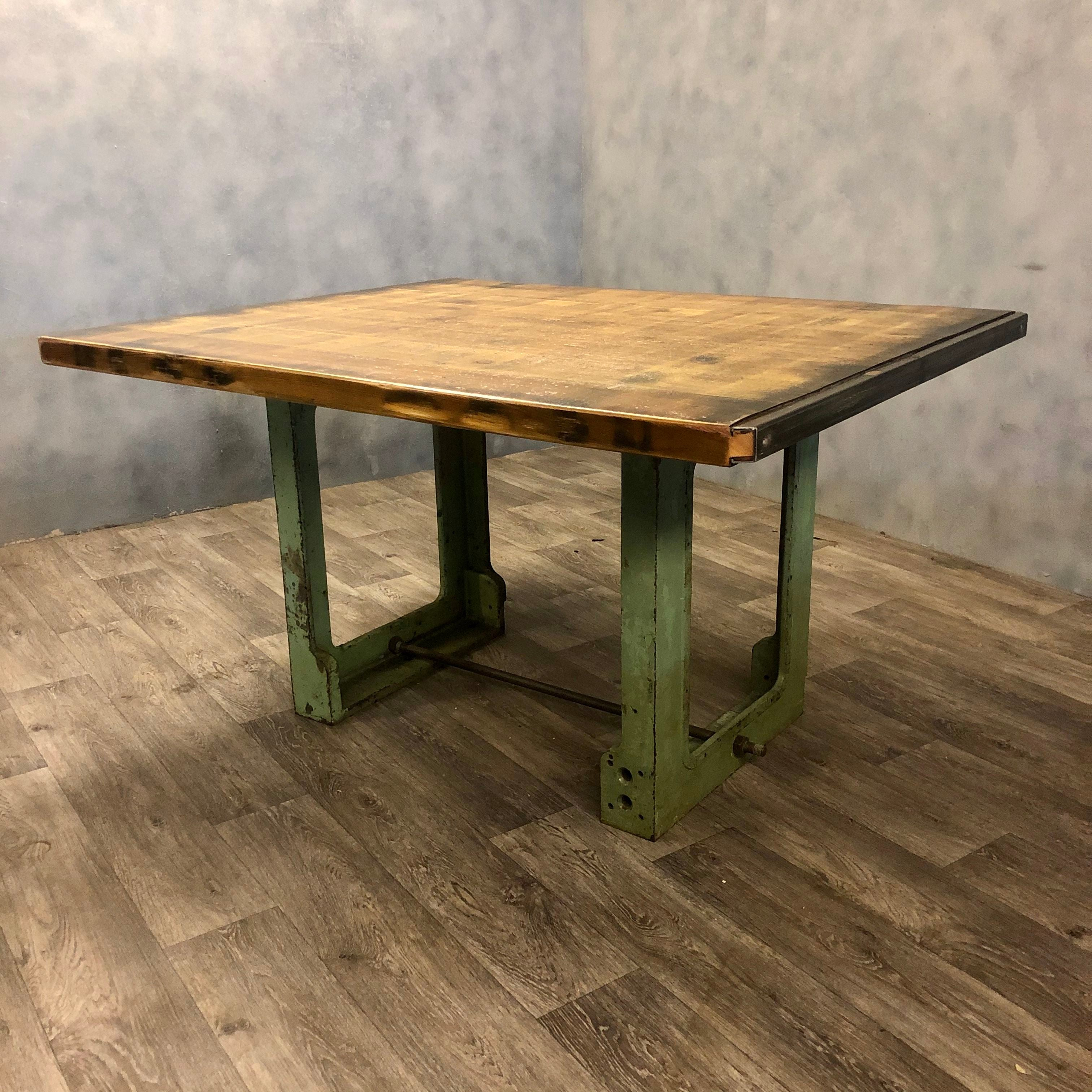 Reclaimed dining table with industrial legs