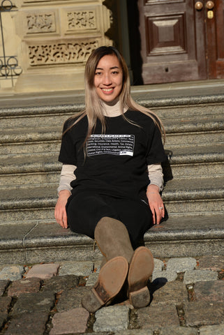 """Model sitting wearing Lady Justice Apparel™ """"A Woman's Place is in Law"""" Designed T-Shirt"""