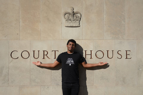 Lady Justice Apparel™ male model wearing unisex design What A Lawyer Looks Like at the Toronto Superior Court of Justice Ontario