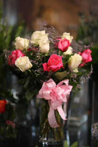 One dozen pink and white roses with vase