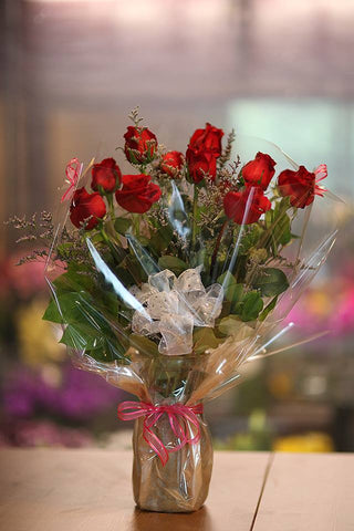 One dozen long stem red roses with vase