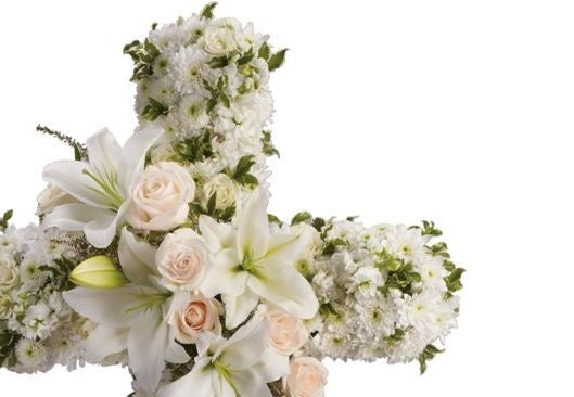 Sympathy cross shape flower arrangement for the service