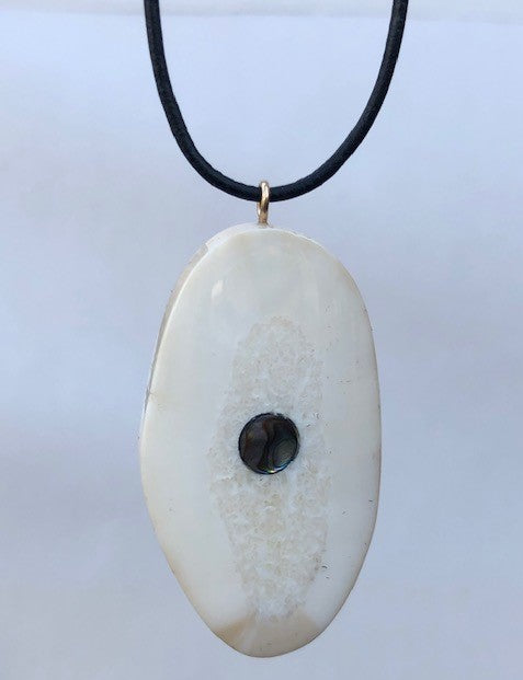 FOSSIL WALRUS IVORY PENDANT WITH LEATHER CORD