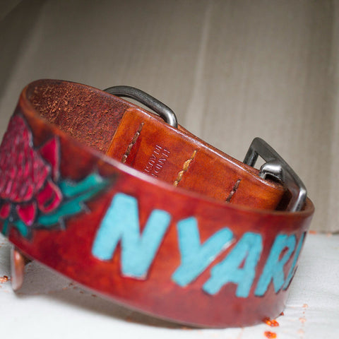 Hand tooled and painted with Australian native plants and dog name. Re-used buckle to help environment. Veg tanned leather