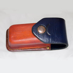 Leatherman Wave Sheath - ready product - Hand made sheath for Leatherman Wave. Veg tanned cow leather wet moulded over 3d printed form. Dyed orange and blue. Stamped with Taurus star sign around snap button closure. Belt slider at the back. Hand stitched with Tiger thread in 0,8mm