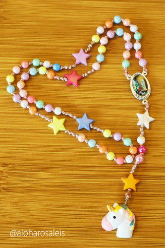 Divine Mother says pray and play! Pastel plastic colored 6mm beads and stars makes this rosary very light and bright. Hand knotted with a touch of unicorn love.