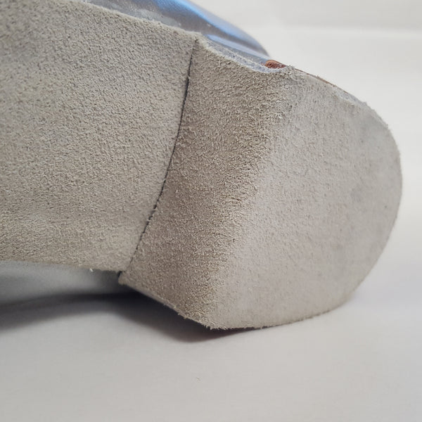 Suede soles wrapped over the front of the heel.