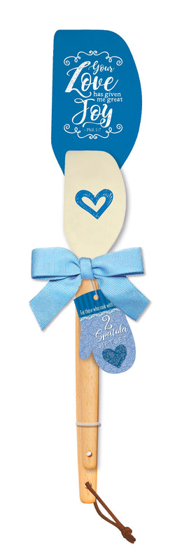 "Our spatula giftset is for those who cook with love. Set includes 2 spatulas with silicon heads and solid wood handles. Large spatula measures 12"" x 2.5"" x 0.75"". Small spatula measures 9.5"" x 2"" x 0.5"". Features scripture. Material: Silicone / Wood."