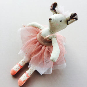 Ballerina Mouse - An Adorable Christmas Gift What a sweet gift! This beautiful Ballerina Mouse has all the sparkle you need to make a little girl's day. This pretty mouse is wearing a shimmery pink tutu dress with silver spotted net underneath. She is wearing a pink tulle bow in her hair to match. She has long elegant legs with pink plush ballet shoes. This star mouse arrives in a pretty pink gift box. Clothing is removable.