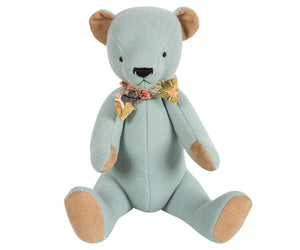Beautiful Blue Teddy Bear - A timeless gift This beautiful blue teddy bear arrives in a floral cloth bag with a matching floral bow tie around his neck. This classic high quality teddy bear is timeless and will be treasured for years to come. Made with soft velour light blue fabric, he has acrylic bead eyes and an embroidered nose and mouth. Showing bear in sitting position