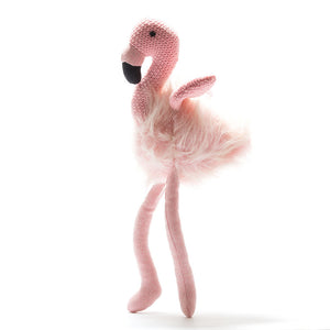 Flamingo soft toy - an adorable pink fluffy gift This large flamboyant flamingo soft toy makes a gorgeous gift for first birthdays and first Christmas. This brightly coloured flamingo has a fluffy body, pretty pink tweed legs and knitted wings. It also has a beautiful black beak and black stitched eyes. Shown on white background