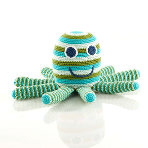 A lovable Octopus Soft Toy - Fair Trade Too This adorable blue and green striped Octopus soft toy makes a gorgeous gift for new babies, christenings and first Christmas. They are hand-knitted by a team of people in rural Bangladesh, as this is a fair trade toy all the workers are fairly paid. Beautiful bright colours.  Handmade, fair trade and adorable! Octopus on white background