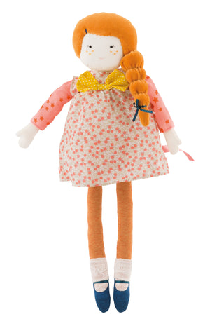 Mademoiselle Colette Doll By Moulin Roty - showing full length picture - a boxed gift – ideal for special occasions. Colette has plush dark orange hair which is tied to the side with an emerald green bow. She is wearing a cute peach patterned dress with a yellow spotty box at the collar.