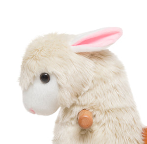 Close Up Head shot of Alpaca -This plush cream ride on Alpaca is the perfect present for small children who love action.  Just push down on the footrest bars and watch this ride on alpaca go. Such fun!   Each animal has a soft plush body and an amazing driving system that enables children to steer with the handles and move the animal along on plastic wheels.
