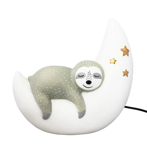 A wonderful sleeping sloth lamp - a superb Christmas Gift.  This cute sloth lamp depicts an adorable grey sloth sleeping on a white crescent moon decorated with three gold stars.  The moon and the sloth create a soothing warm glow perfect for a children's bedside table, especially during the winter. A great gift for little ones who don't get to sleep easily as well as those who love an on-trend bedroom accessory.