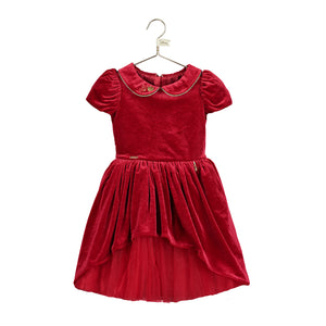 This rich ruby velvet Snow White dress from Disney is adorned with a gold piped Peter Pan collar. It has pretty gathered short sleeves. The full velvet skirt has a high - low hemline revealing a red twinkling