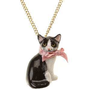 Black and White Cat Necklace - beautifully designed porcelain cat necklace with a pink bow. Handpainted. Designed in Scotland.