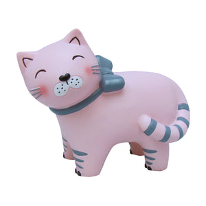 A gorgeous children's light depicting a happy pink cat wearing a grey bow. At bedtime, it's reassuring for some to have a children's night light in the room. What better way to create an atmosphere of calm than a pretty pink cat night light. Showing unlit cat lamp on white background