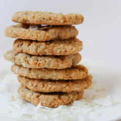 Trove Desserts stack of handmade Coconut Oatmeal Cookies on a bed of coconut