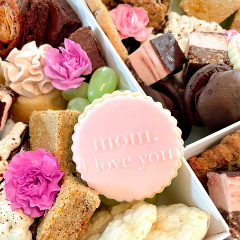 Trove Desserts grazing assorted dessert boxes for Mother's Day with raspberry nanaimo bars, flowers, earl grey and orange bar, lemon crinkle cookies, and a custom hand stamped sugar cookie