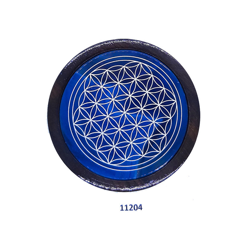 Flower of life on agate gemstone coaster surrounded with wood.