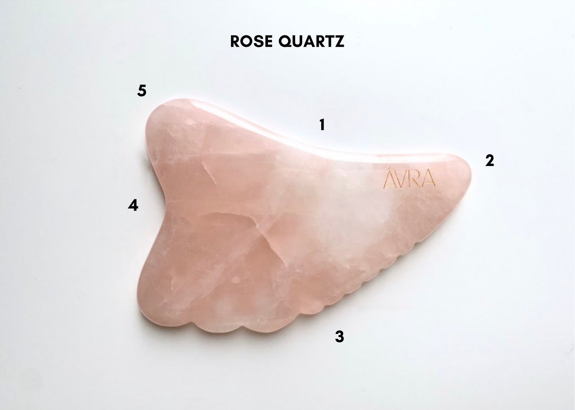 rose quartz gua sha labelled with numbers on each side