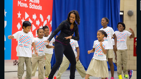 michelle obama is dancing with children at school