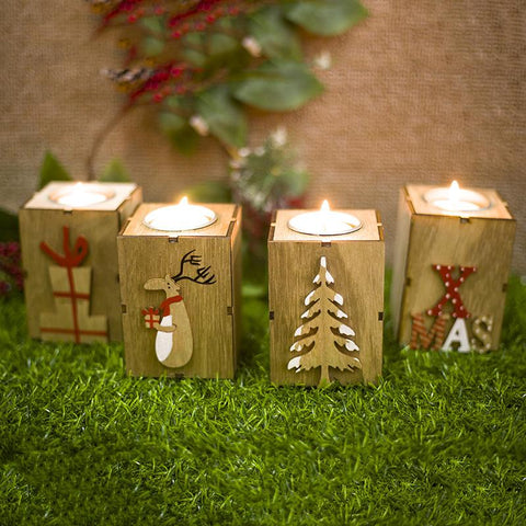 candles in wooden boxes with Christmas theme