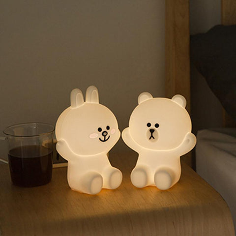 teddy bear led night light with different facial expressions at bedside