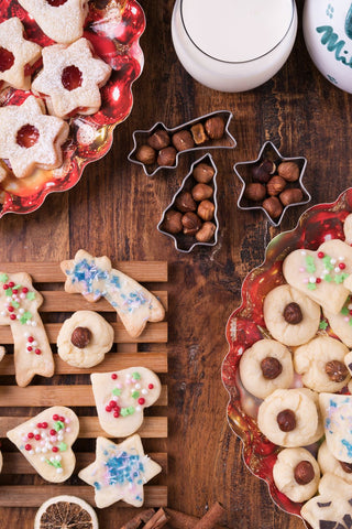 Milk and strawberry marmalade and hazelnut Christmas cookies in different shapes and sizes