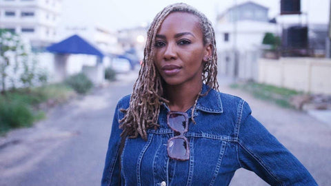 opal tometi with denim jacket and sunglasses