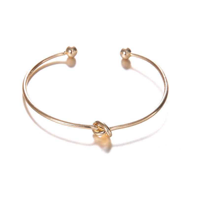 knotted vintage gold colored bracelet for women