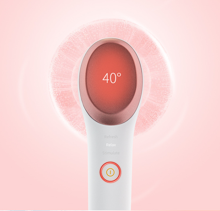 White-colored eye and face massager shows 40 degree on monitor