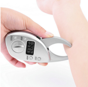 Women using digital body fat caliper measurement tool shows the percentage on a monitor
