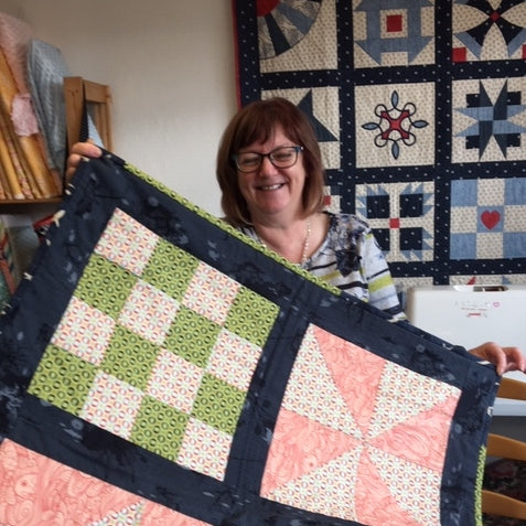 Gail with a quilt at In Stitches, Stroud