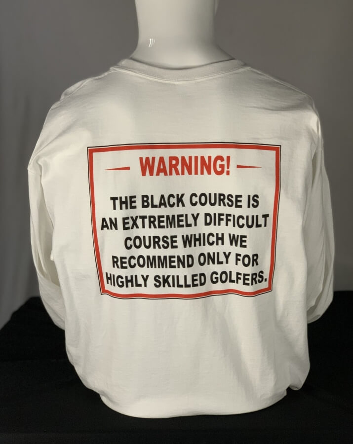 Bethpage Black Warning Sign displayed on back of white long sleeve tee