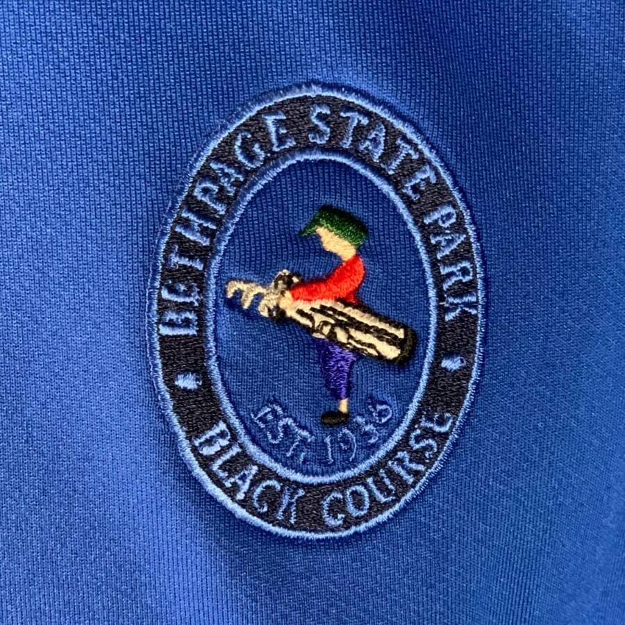 Bethpage Black Course logo displayed on the blue Dunning Zip Up
