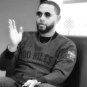 Director X Wearing 100 Miles Sweater and Speaking The History